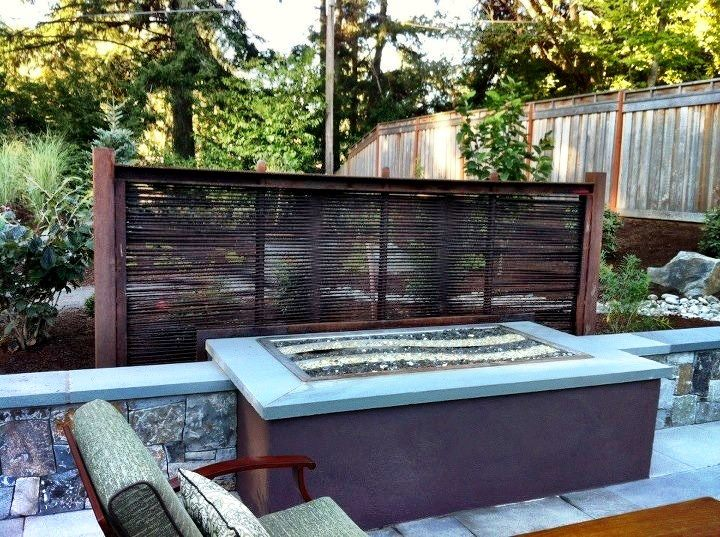 Rebar Screen with Corten and Stainless Fire Table with Lava Rock