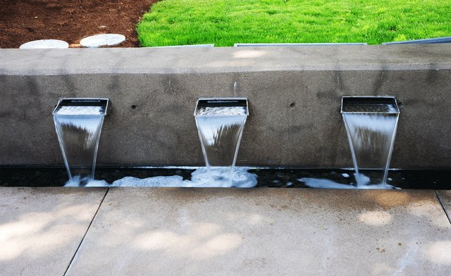 Stainless Spillways Cantilevered to Concrete Wall