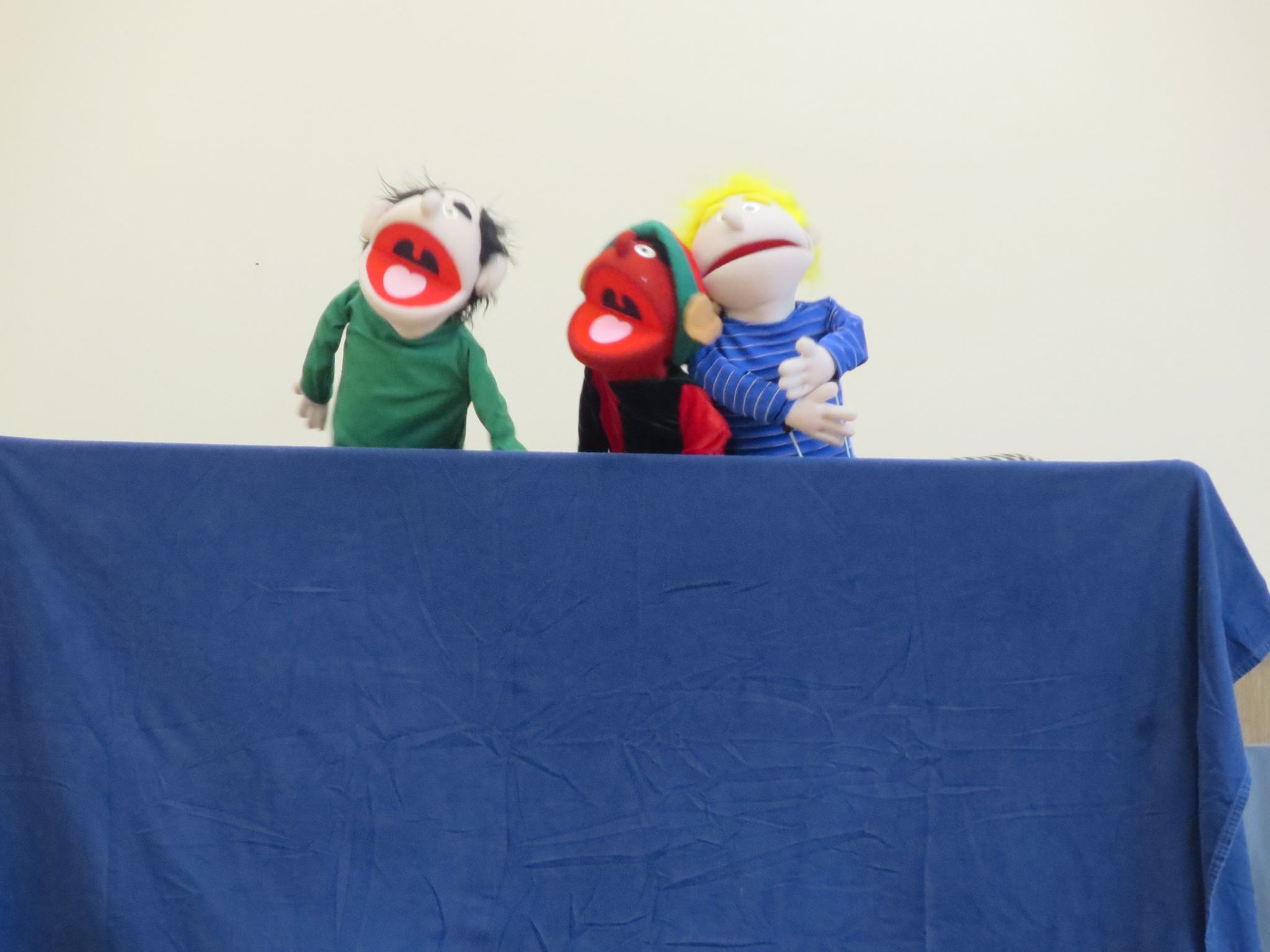 Putting on a puppet show.