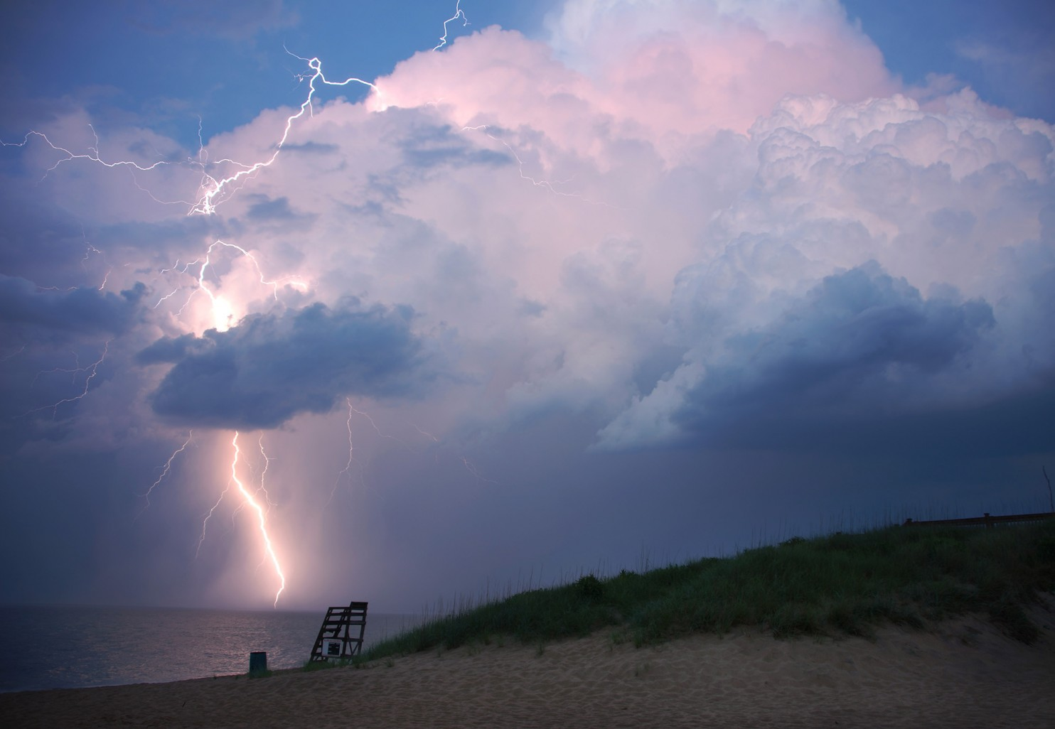 A small thunderstorm during sunset at Kill Devil Hills, North Carolina, June 12, 2016. Photo credit: Kevin Ambrose