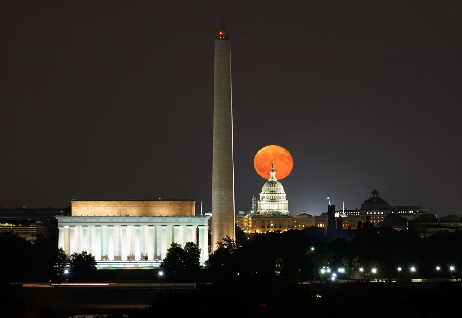 The Harvest Moon rises above Washington D.C., September 17, 2016. Photo credit: Kevin Ambrose