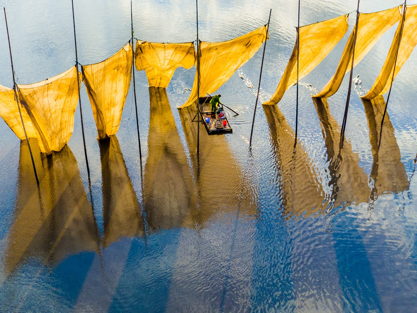 "Grand Prize. ""Fishermen Closing The Net"" shot near Yacheng Bay, China. Photo by Ge Zheng."