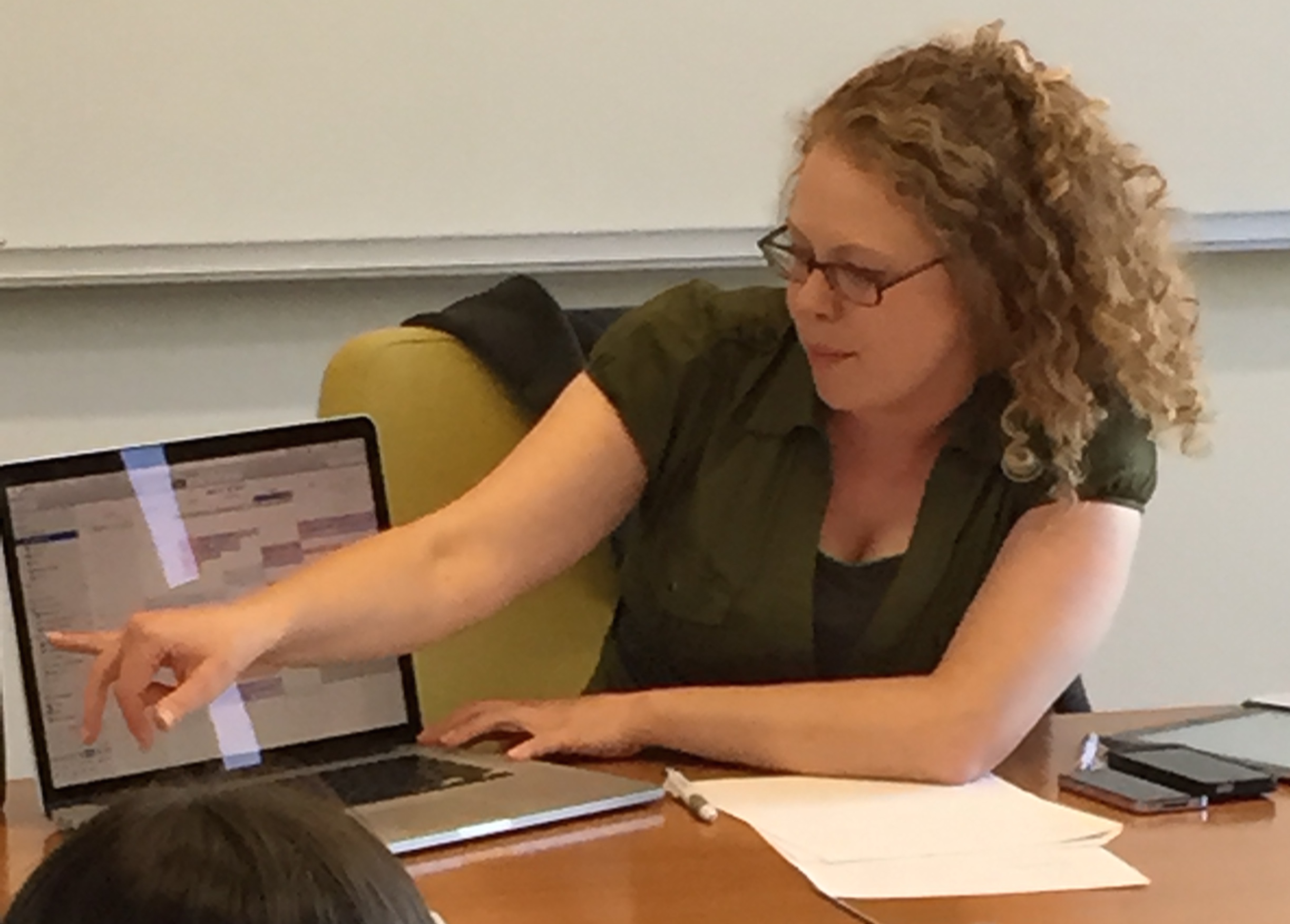 Brittany (Productivity coach) is presenting on task management and calendar management to an ADHD Coaching group. She is recommending apps to use on computers, iPhones, and iPads. She is pointing out calendars that might be useful to use.