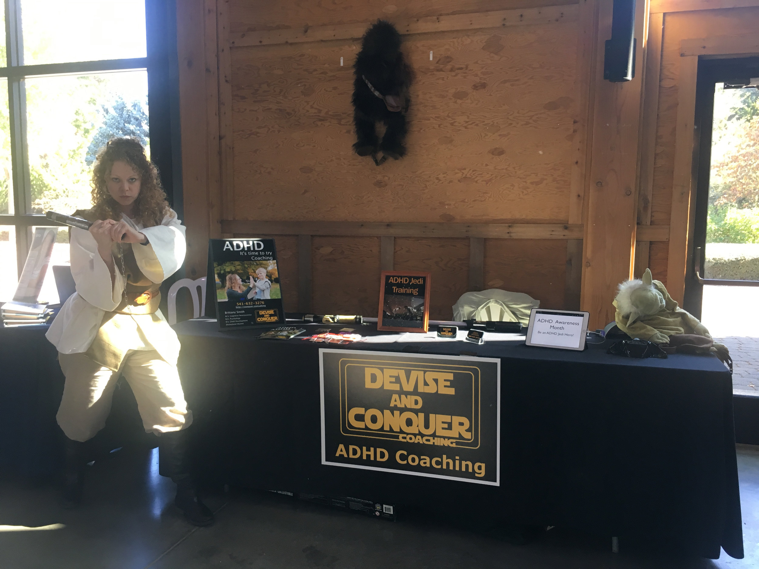 Brittany the ADHD Coach, with Devise & Conquer booth at School Counselor's conference.jpg