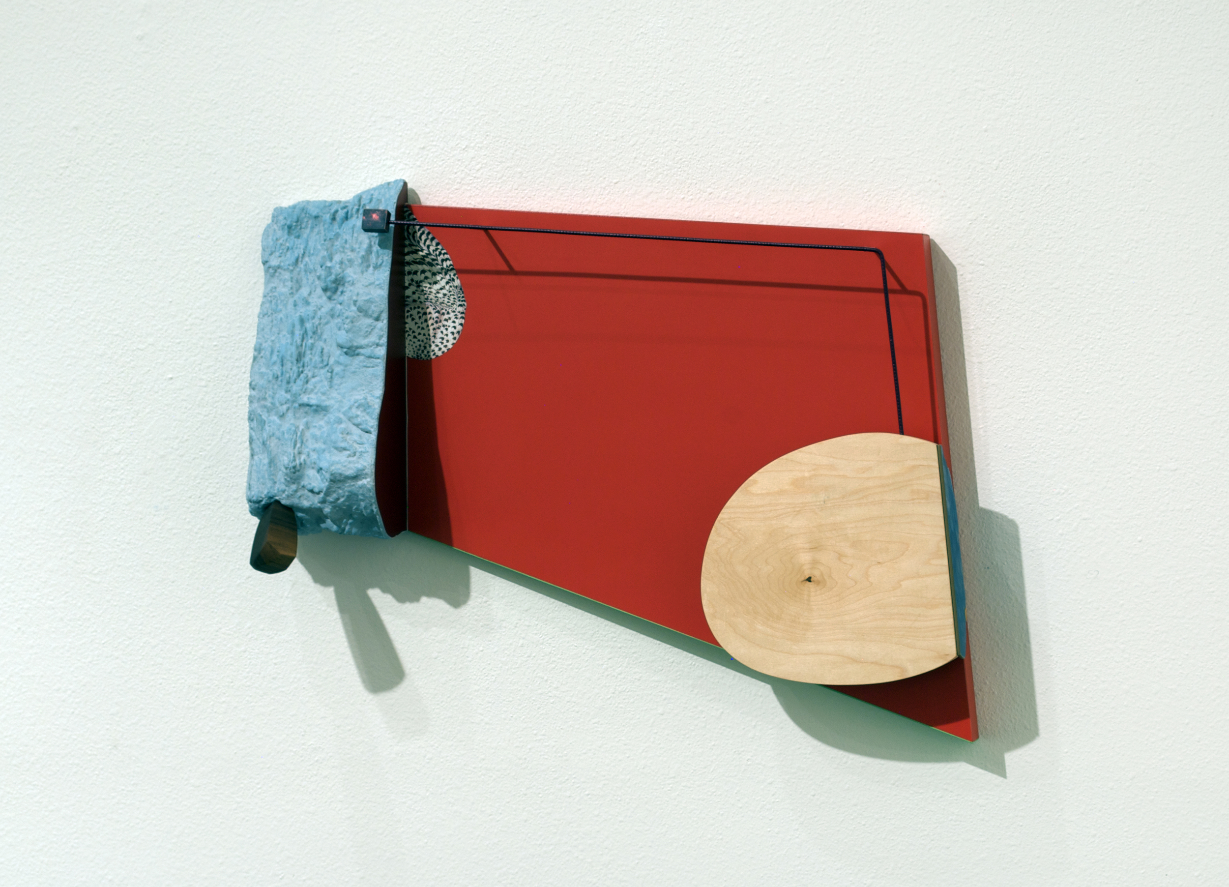 He smoked cigars and told funny jokes,  2012  wood, formica, foam, paint, and cut paper. 20 x 28 x 6.5 inches