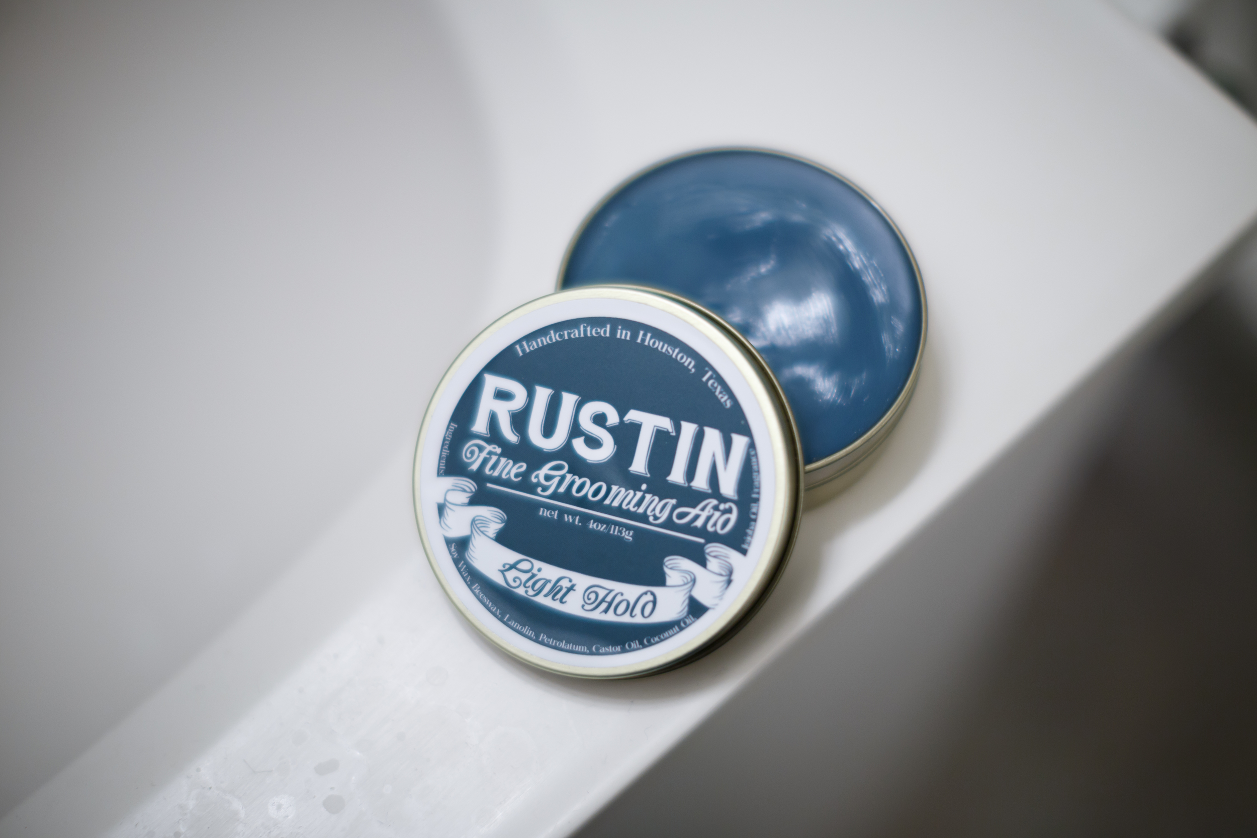 Inside Can of Rustin Light Hold Pomade