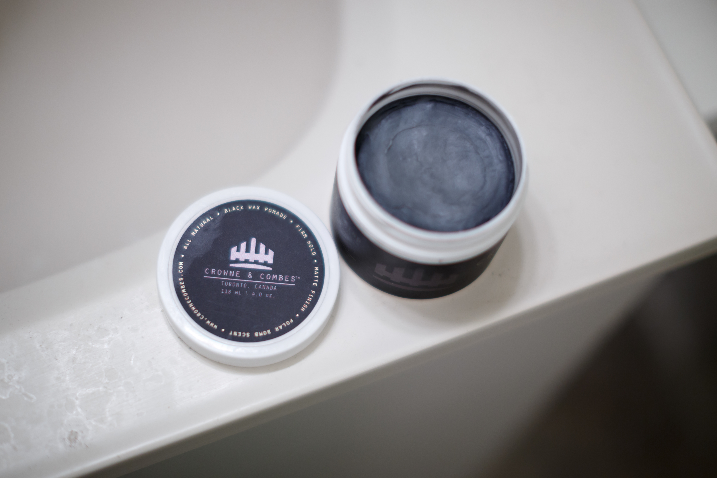 Crownes & Combes Black Wax Pomade Hair Hairstyle Hairstyling Pomp Pompadour ThePomp The Jar Can Tin Container Matte Finish Strong Medium Heavy Firm Hold Opened Inside Product Gray