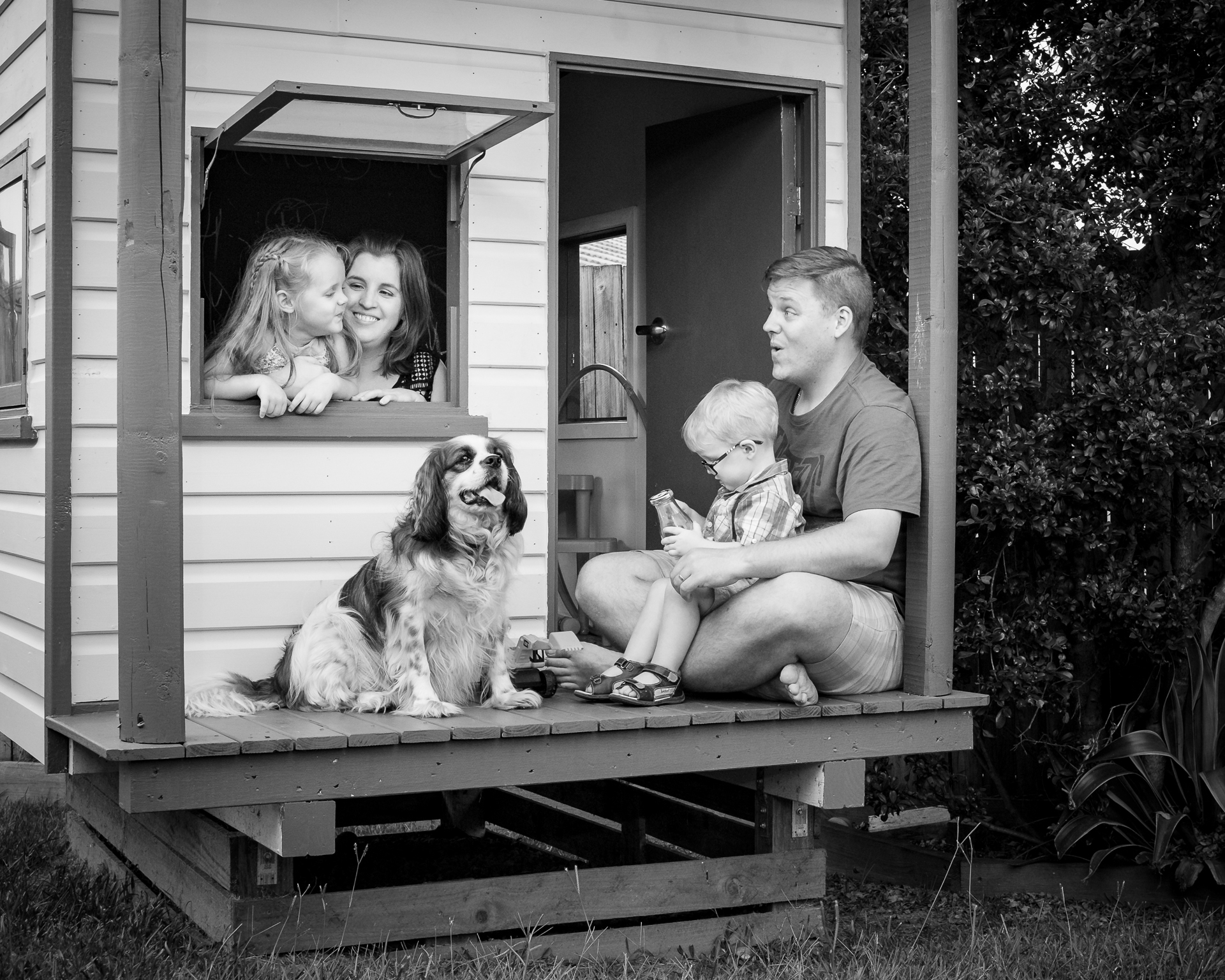 Family in cubby house