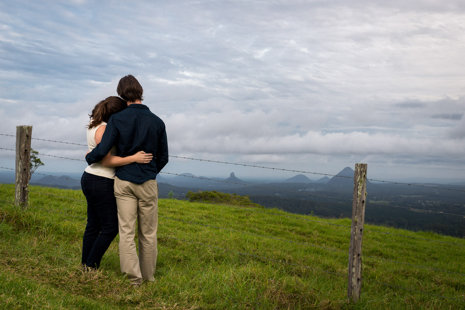 couple embracing with mountains in background