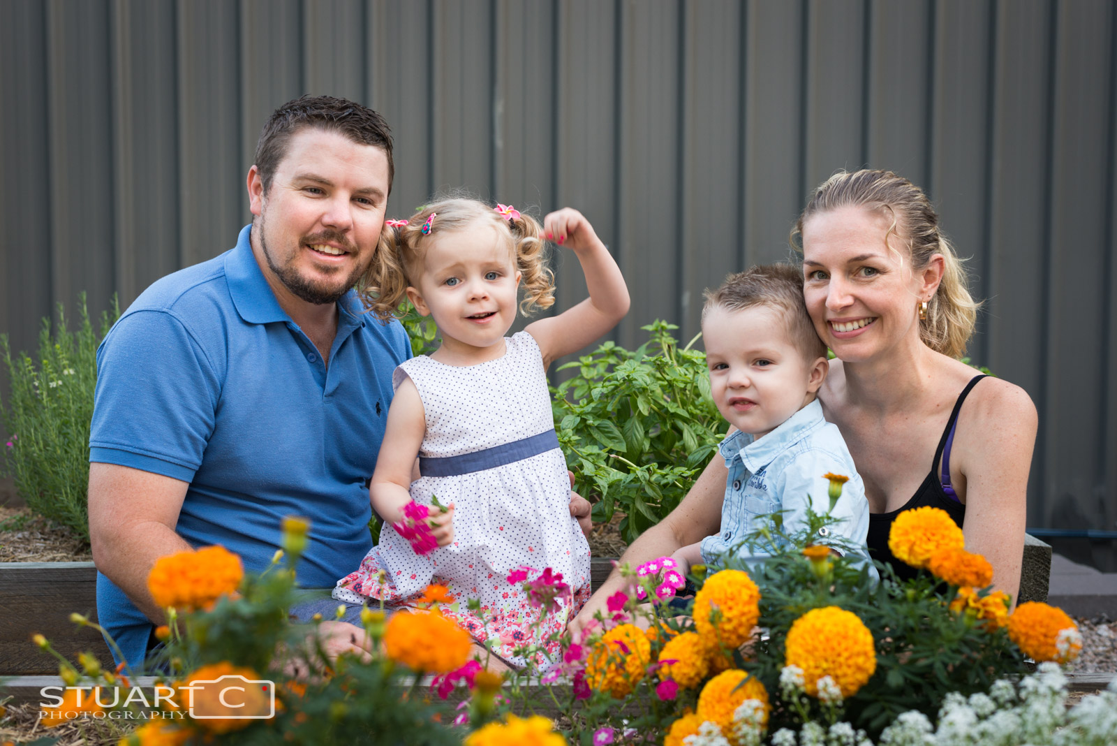 Outdoor family photo in their backyard vegie patch