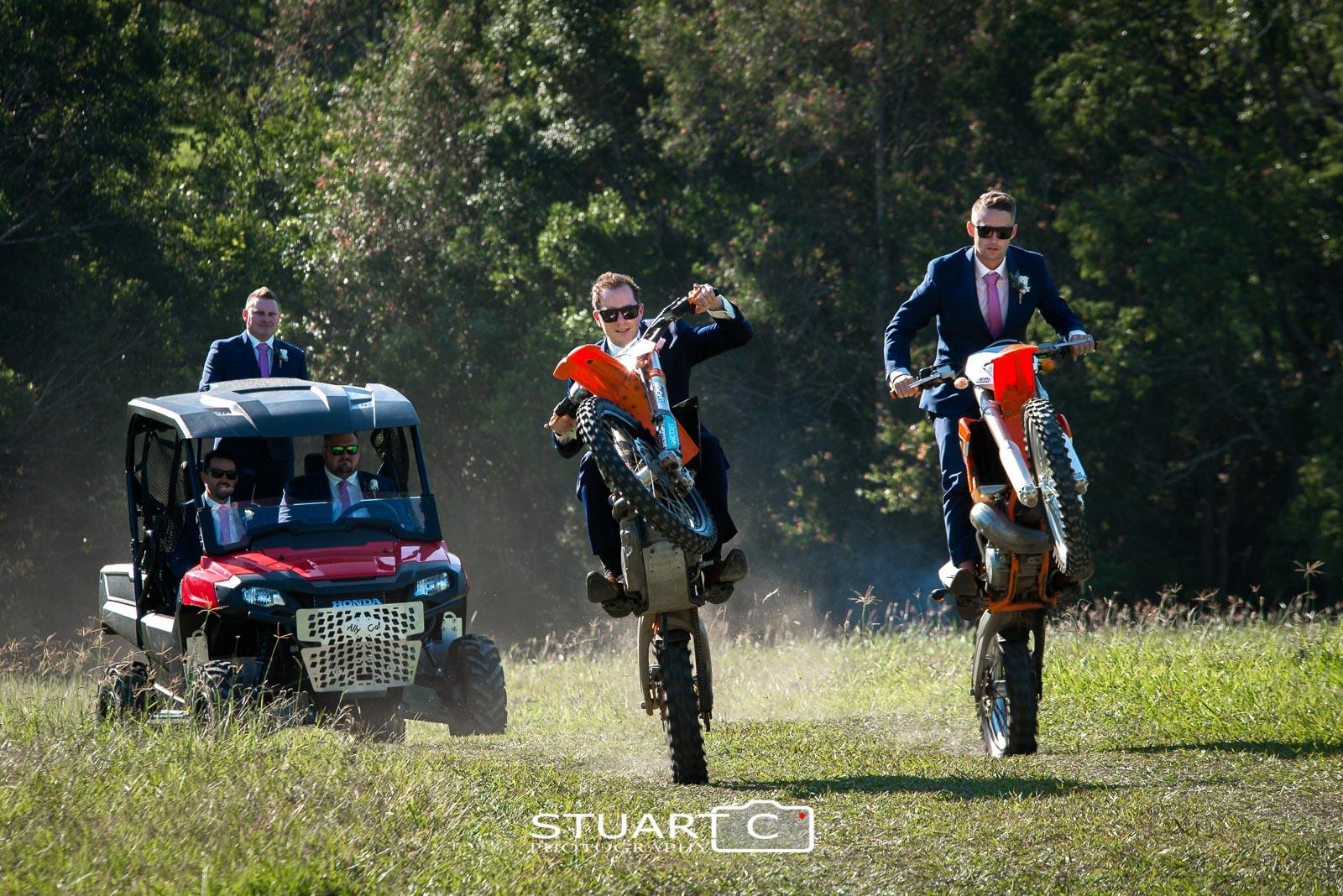Groom and Groomsmen on motorbikes pulling wheely