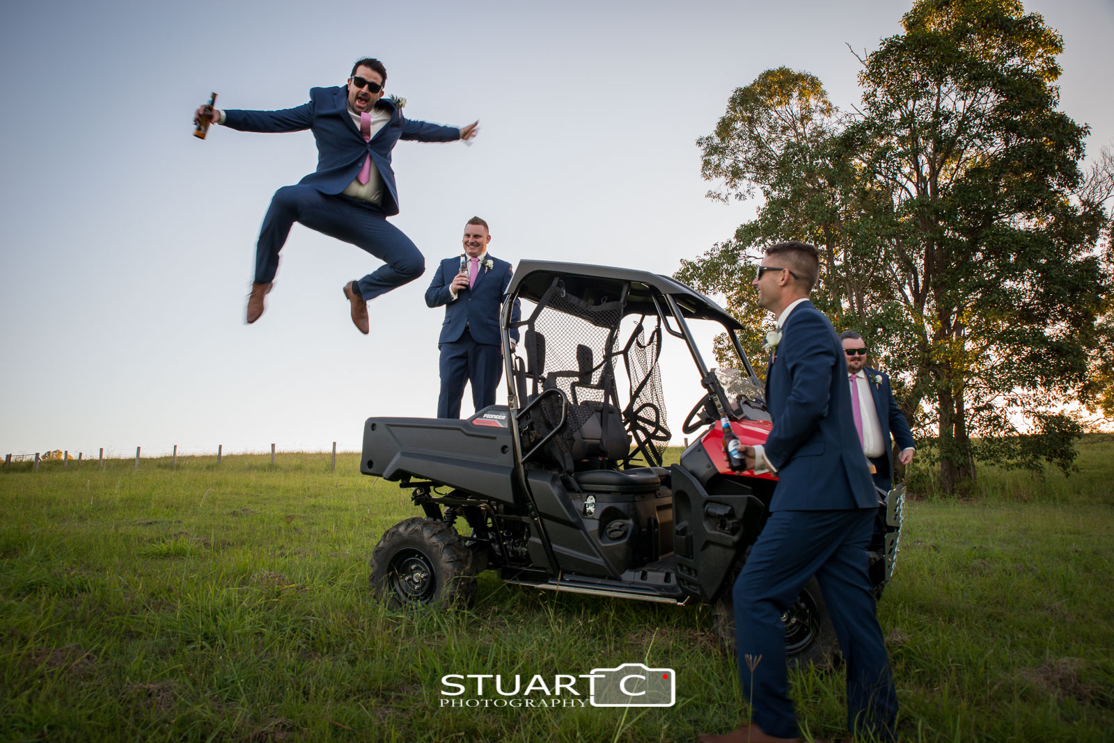 Groomsman jumping out of ATV