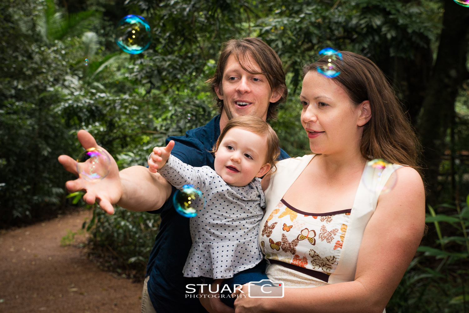 family with bubbles in rainforest at Mary Cairncross Reserve Maleny Sunshine Coast Hinterland