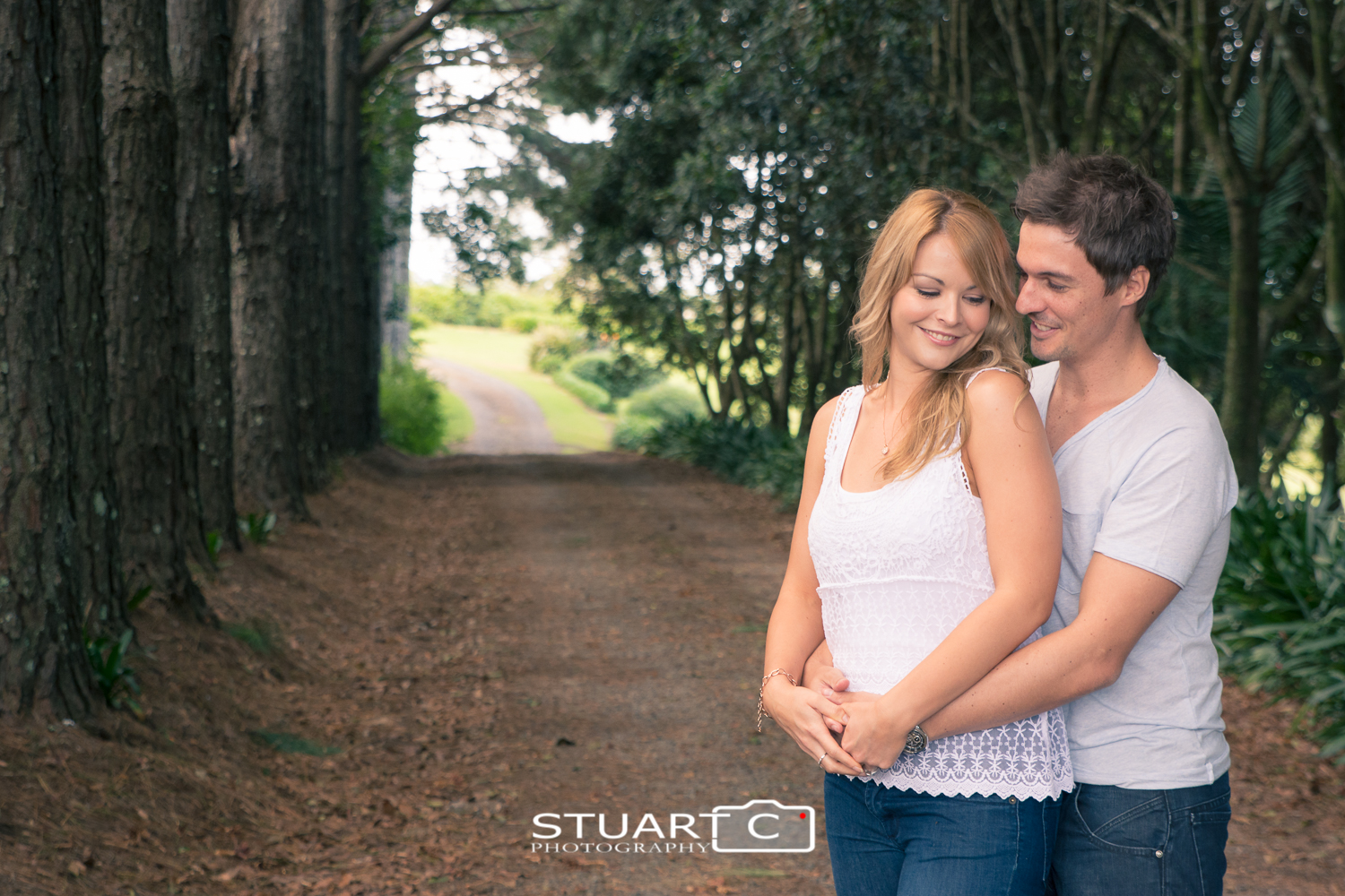 engaged couple on tree lined driveway maleny