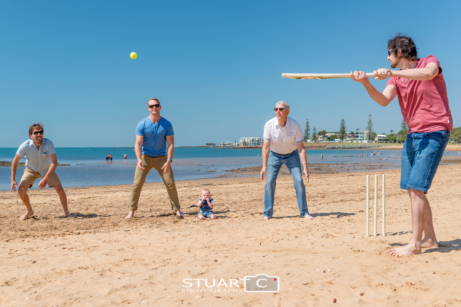 family group playing beach cricket at scarborough