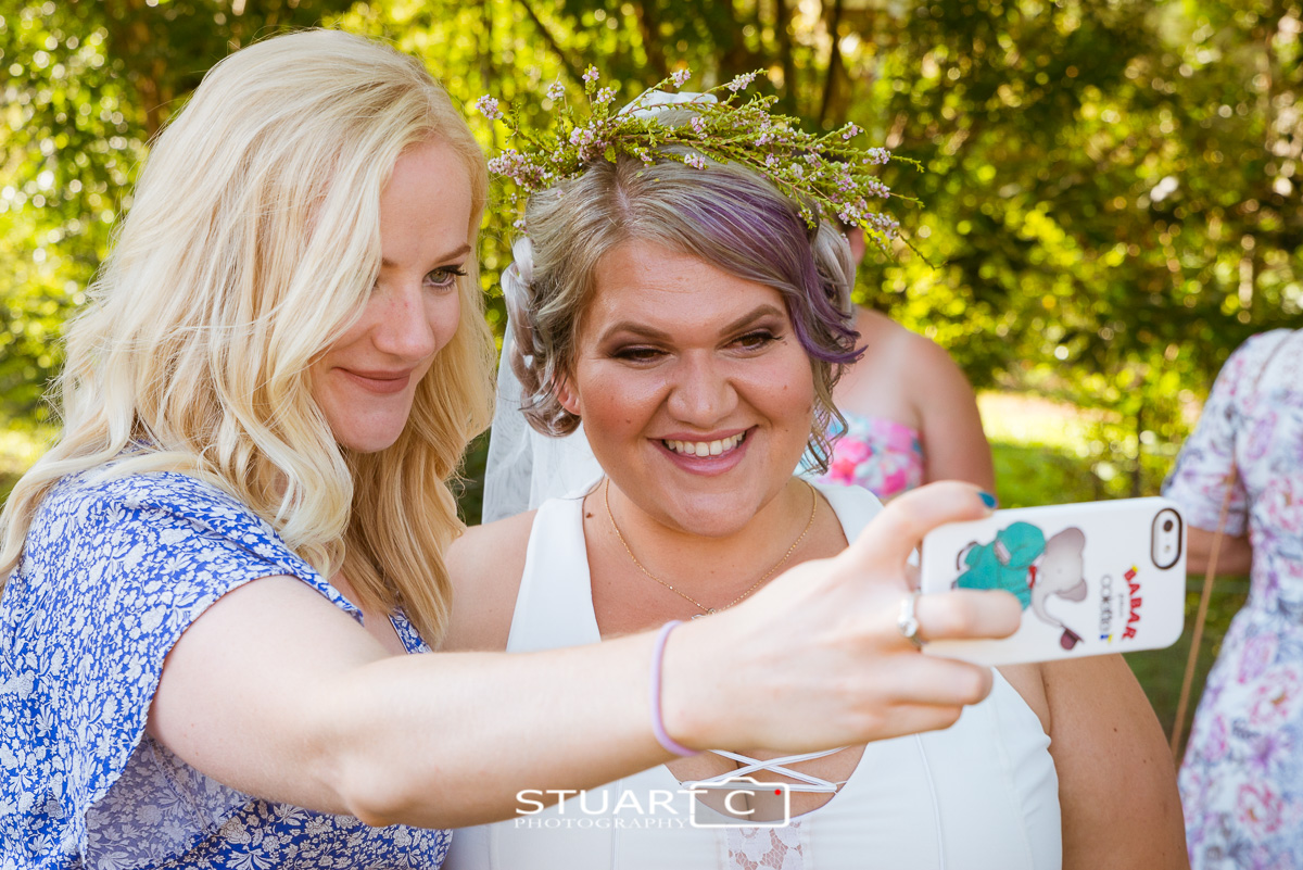 Bride and guest taking a selfy at home wedding in Elimbah