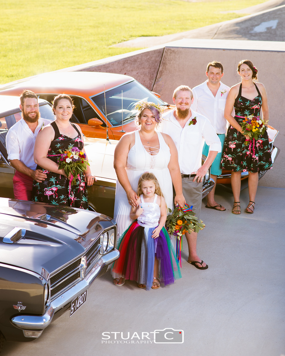 Bridal Party standing alongside old cars in the middle of skatepark in Elimbah