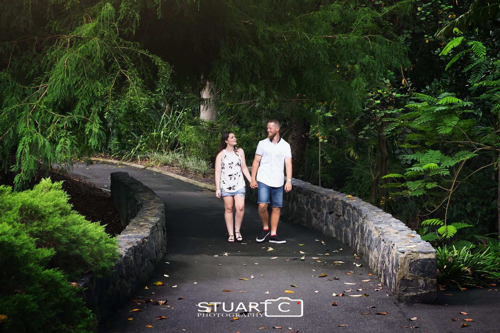 Newly engaged couple, Casey and Gary, enjoying a walk over the foot bridge at Mt Cootha Botanical Gardens during their photo shoot.