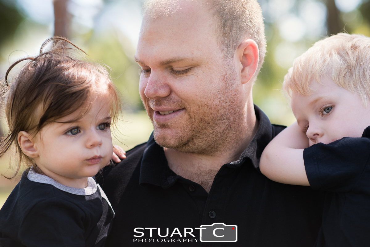 Outdoor natural light Portrait of father and his two sons in a Beachmere park