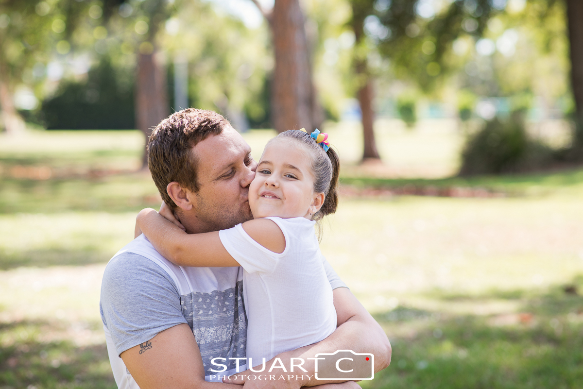 dad and daughter outdoor family portraits in clayton park off briggs avenue beachmere