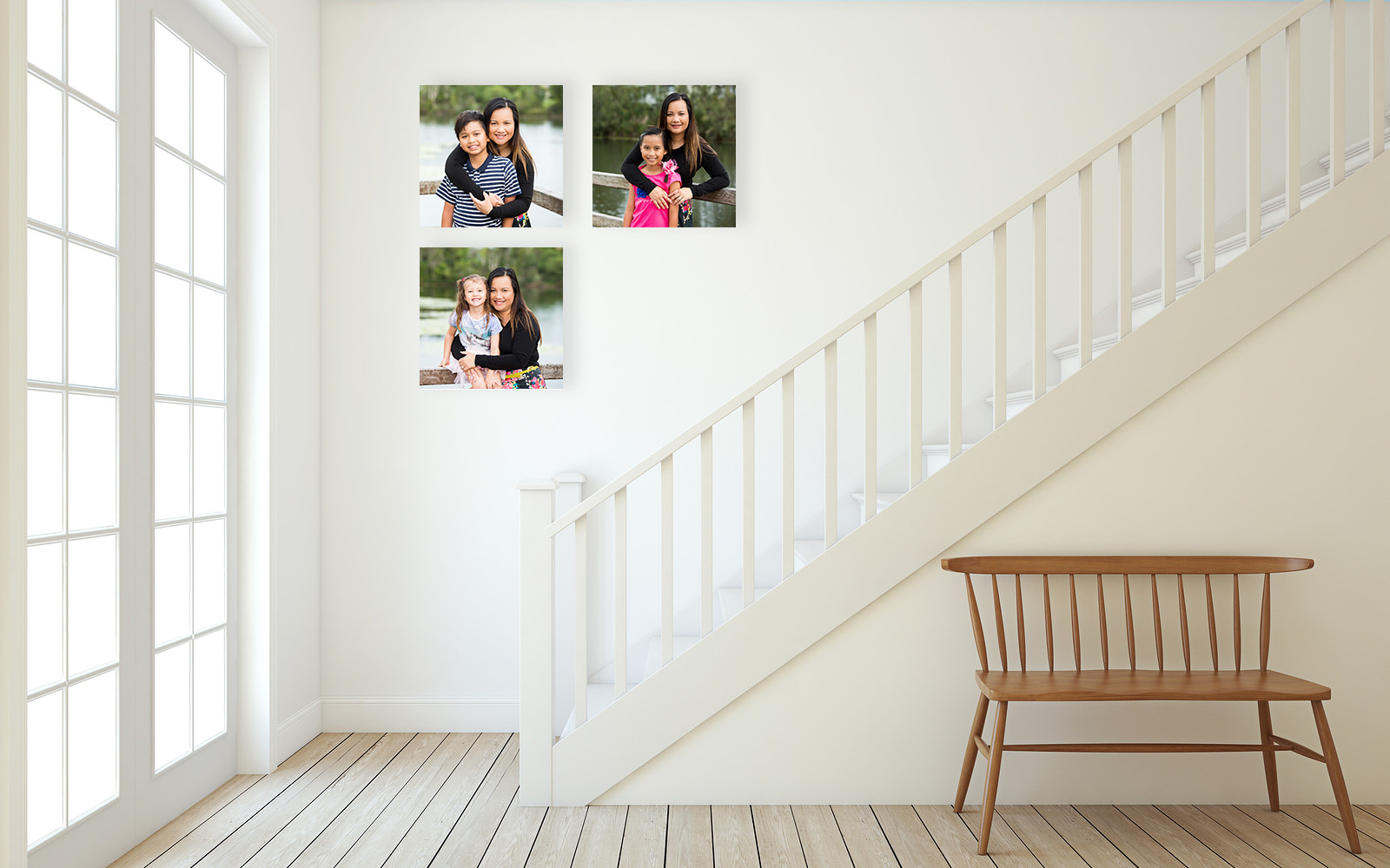 Family portraits shown on 3 canvas prints in hallway going up stairs by caboolture outdoor family photographer