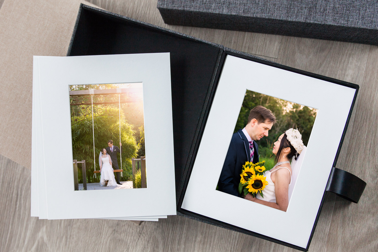 Matted prints in a display box displaying wedding photos from Sunshine Coast Chapel
