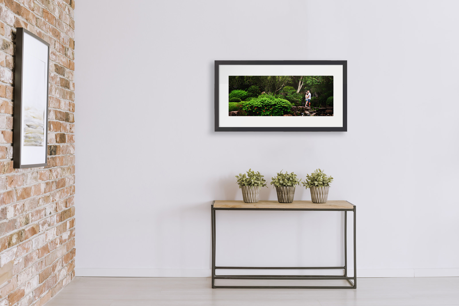 Framed print of engaged couple in garden shown above a hall table