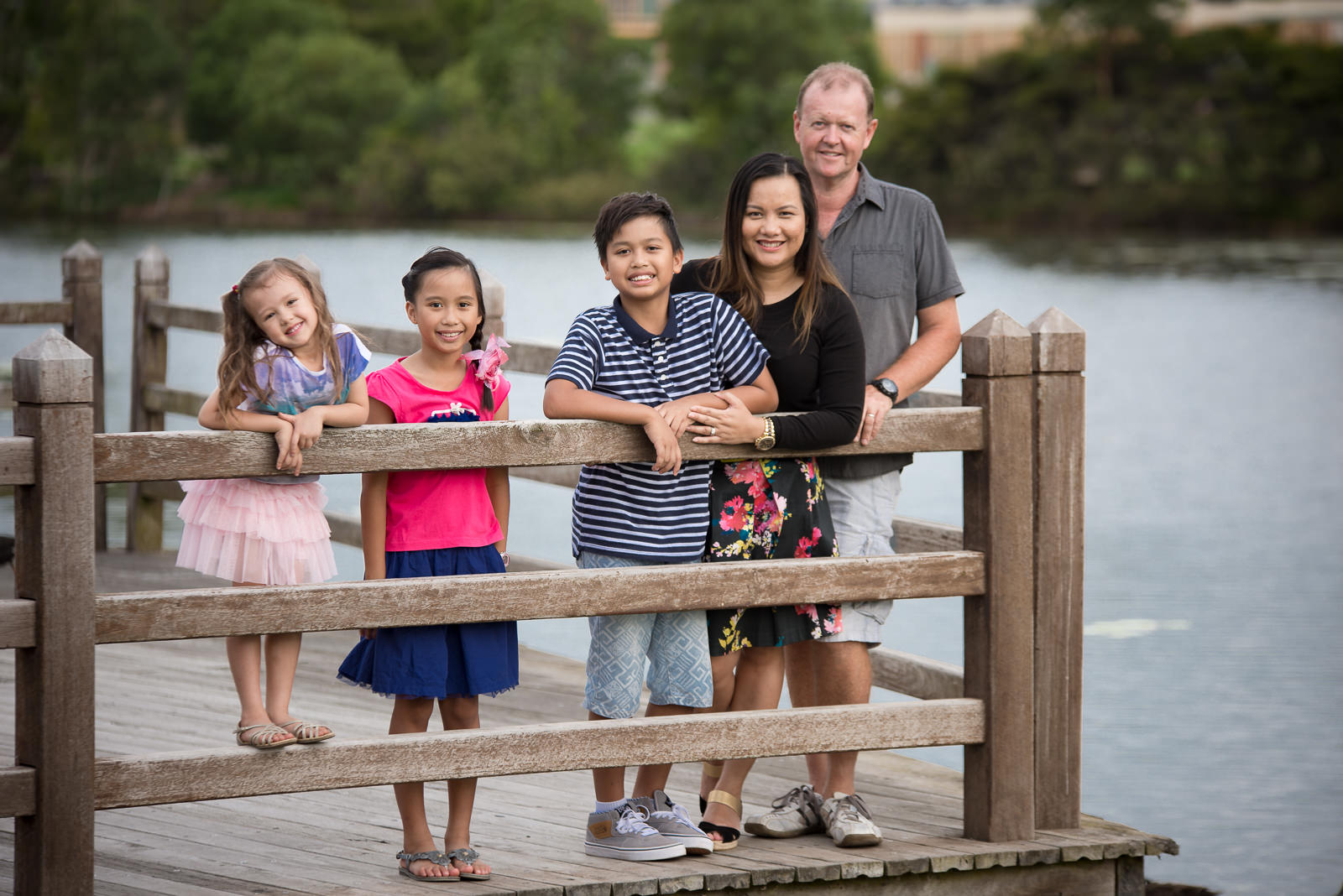portrait of family of five standing on a deck over Lake Eden North Lakes
