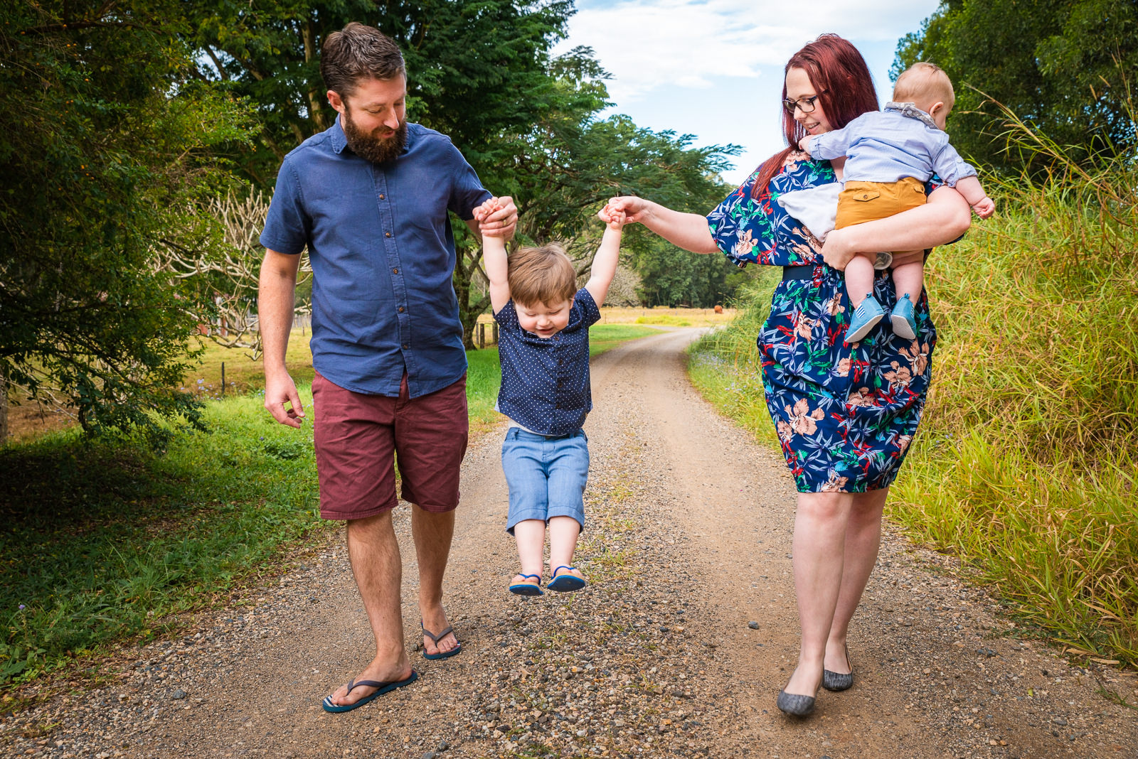 family walking down dirt road at beerwah during family photo session