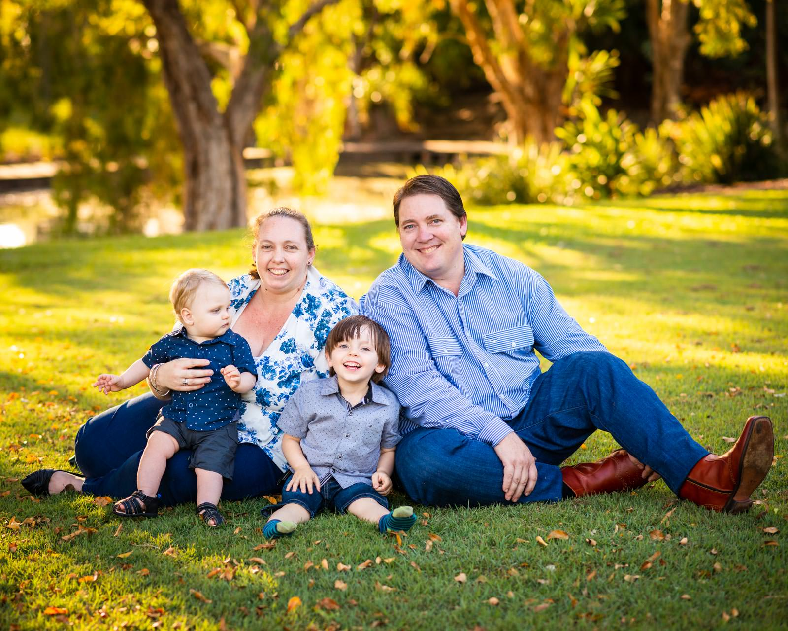 family portrait in golden sunlight at Centenary Lakes, Caboolture