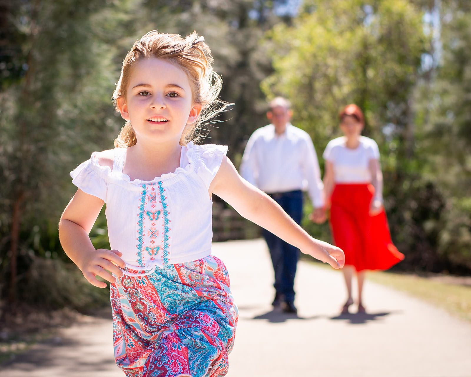 Running and action family portrait at Lake Eden North Lakes
