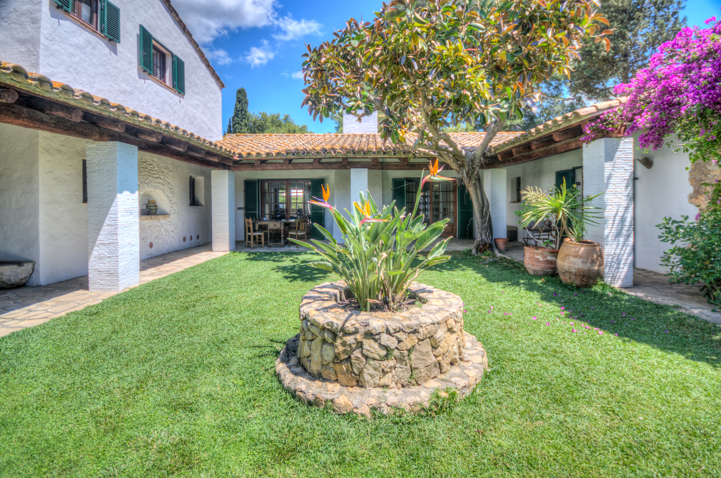 29 Masia Pairal patio with access main vill and wing.jpg