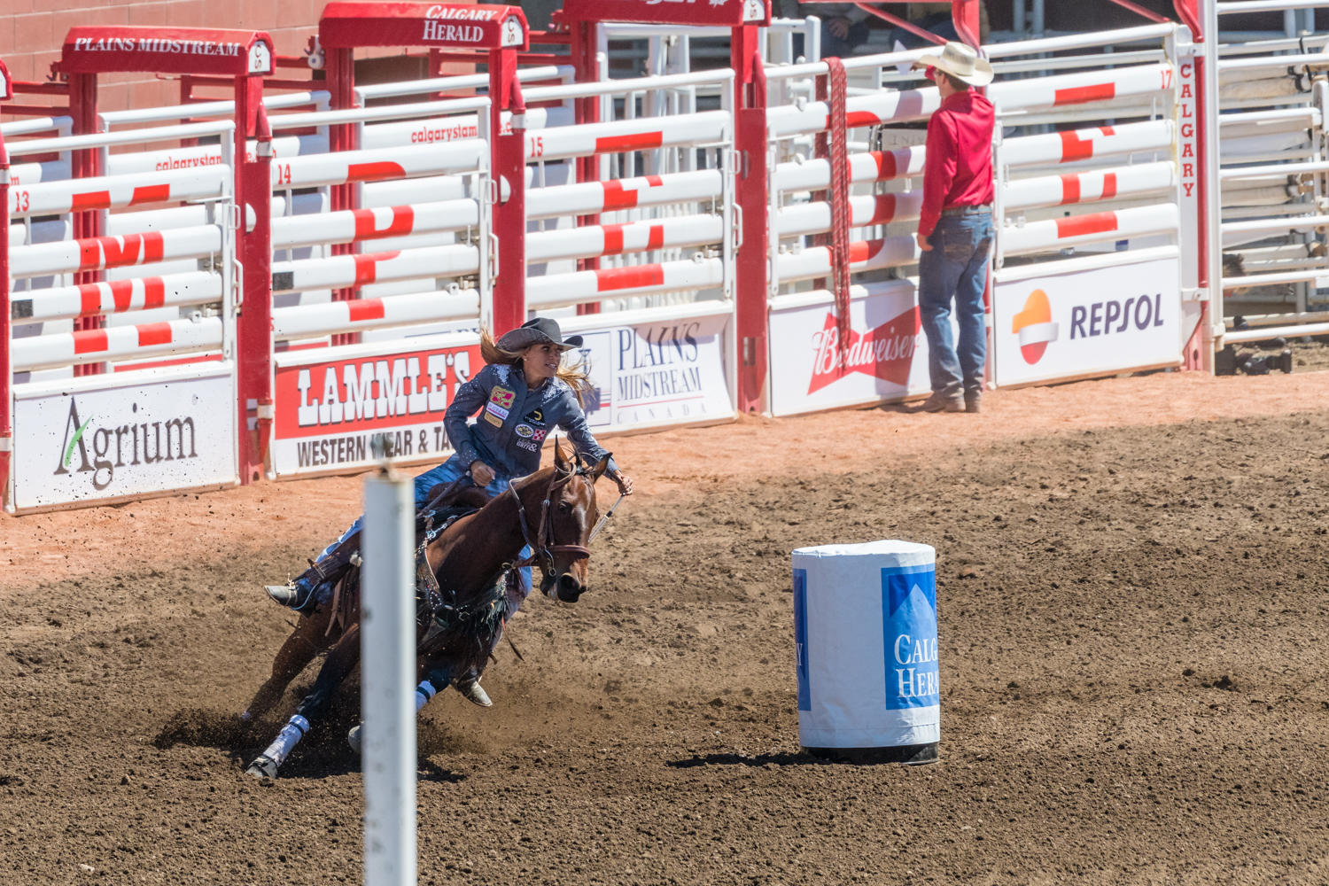 Barrel racing seemed more straight forward than the other events. There were 3 barrels in the arena. The cowgirl had to run around the middle two barrels (in any order), then the far barrel before a mad dash to across the arena to where she started.