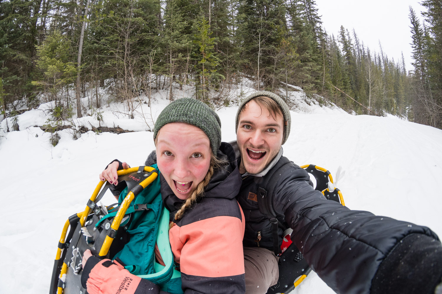 Riding a crazy carpet with Katie. A crazy carpet is basically a sheet of plastic with two holes at the front to dig your feet into. We hiked uphill and broke out the crazy carpet for the downhill sections of our hike to Wapta Falls.