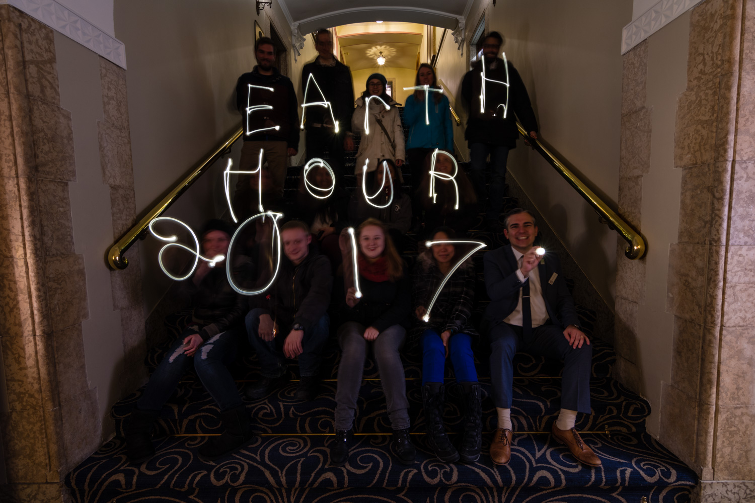 """Taking this photo was one of the funniest things I have ever done. With my camera setup on a tripod for a long exposure I had to direct everyone to write out each letter of """"Earth Hour 2017"""" using electric candles. I would tell everyone to get ready and they would hold there candle in the ready position, I told them to go and they would all start waving their candle in the air. I felt like I was some sort of wizard professor teaching junior wizards how to cast spells."""