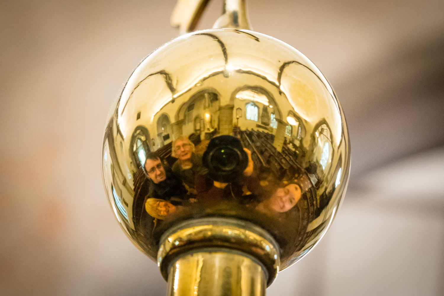 """Visiting the church where it all happened. This """"selfie in the brass sphere"""" was one of my favourite photos to show people during photo lessons around the Chateau in Lake Louise. We used the brass sphere on top of the fancy luggage trolleys scattered around the hotel lobby. It is an interesting way of photographing the whole family."""