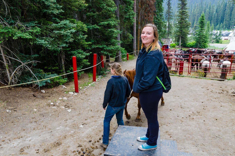 Erika waiting to mount a horse.