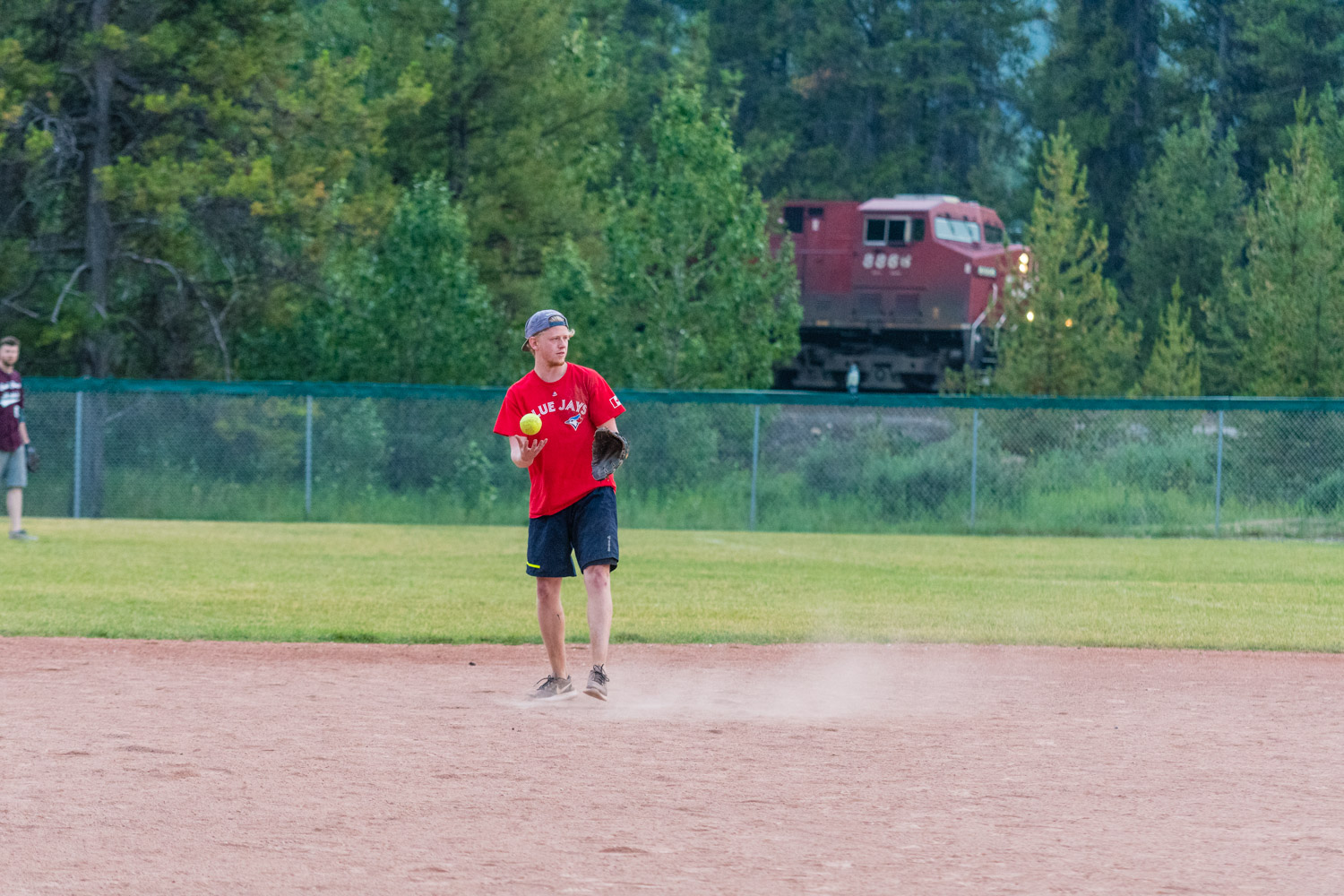 Action shot involving a train and softball. Not many photographers can deliver that!
