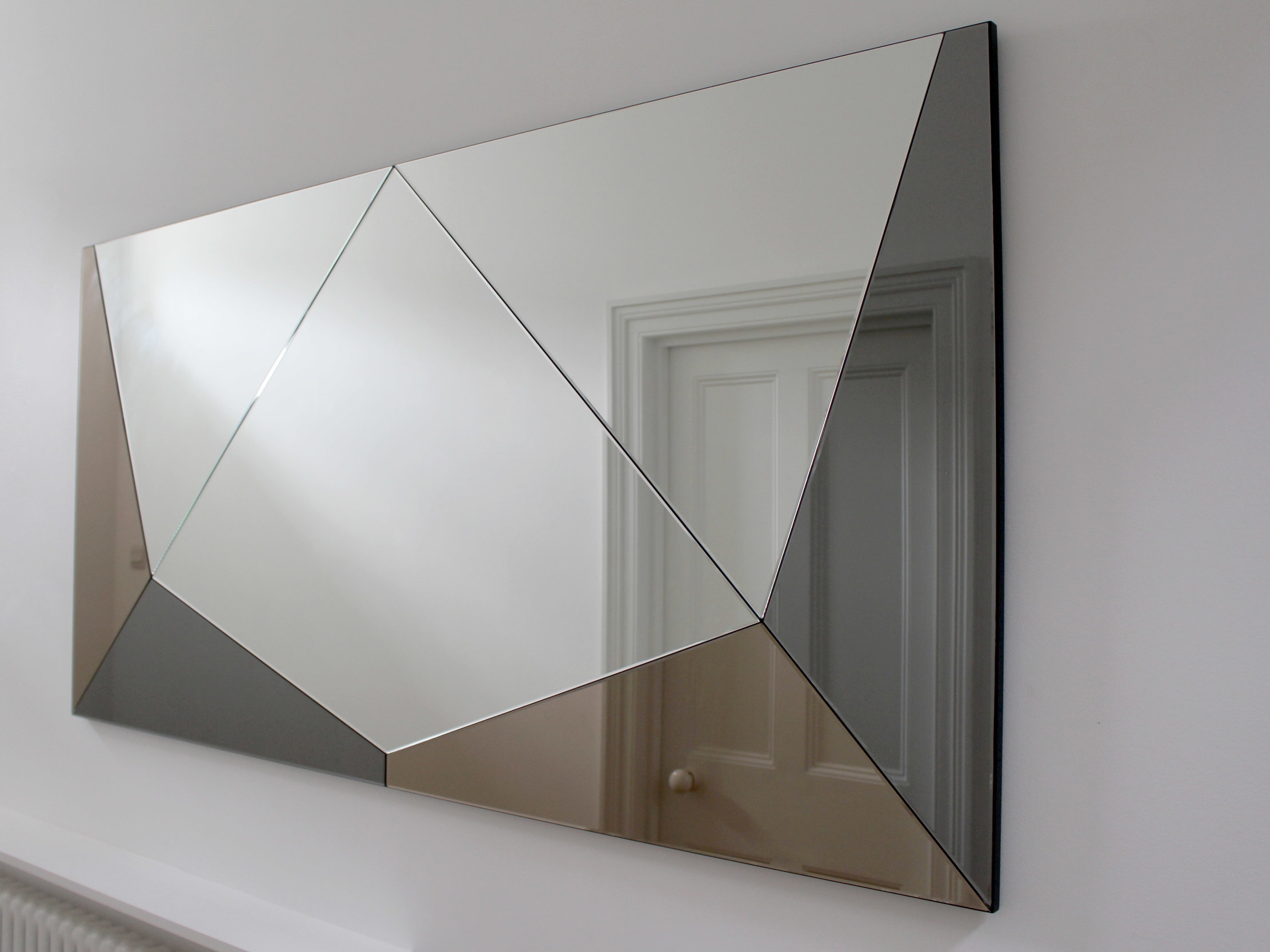 Bespoke Mirrors - offers a bespoke mirror design and manufacture service for individuals and professionals. Haidée has over ten years experience interpreting your ideas and requirements into beautifully designed and finishe mirrors and wall pieces. All mirrors are handmade in the UK with the help of carefully selected manufacturers.