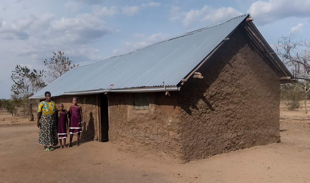 Martha built this house using the microfinance scheme. -