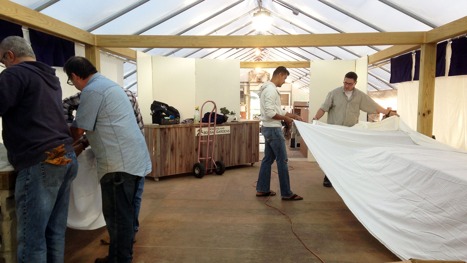 Jorge, John, Chau (that's me!), and Neil setting up tables and backdrop