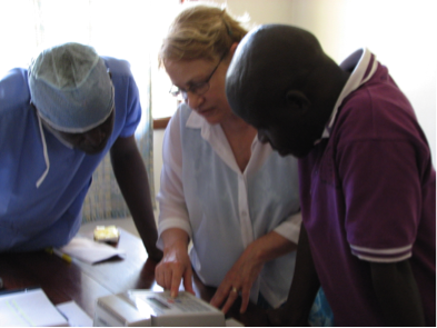 Training staff to use the new INR machine to monitor anticoagulation in patients in Congo.