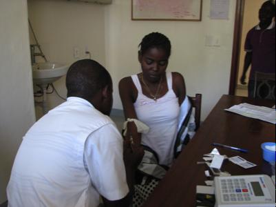 Adokorach having her blood checked.