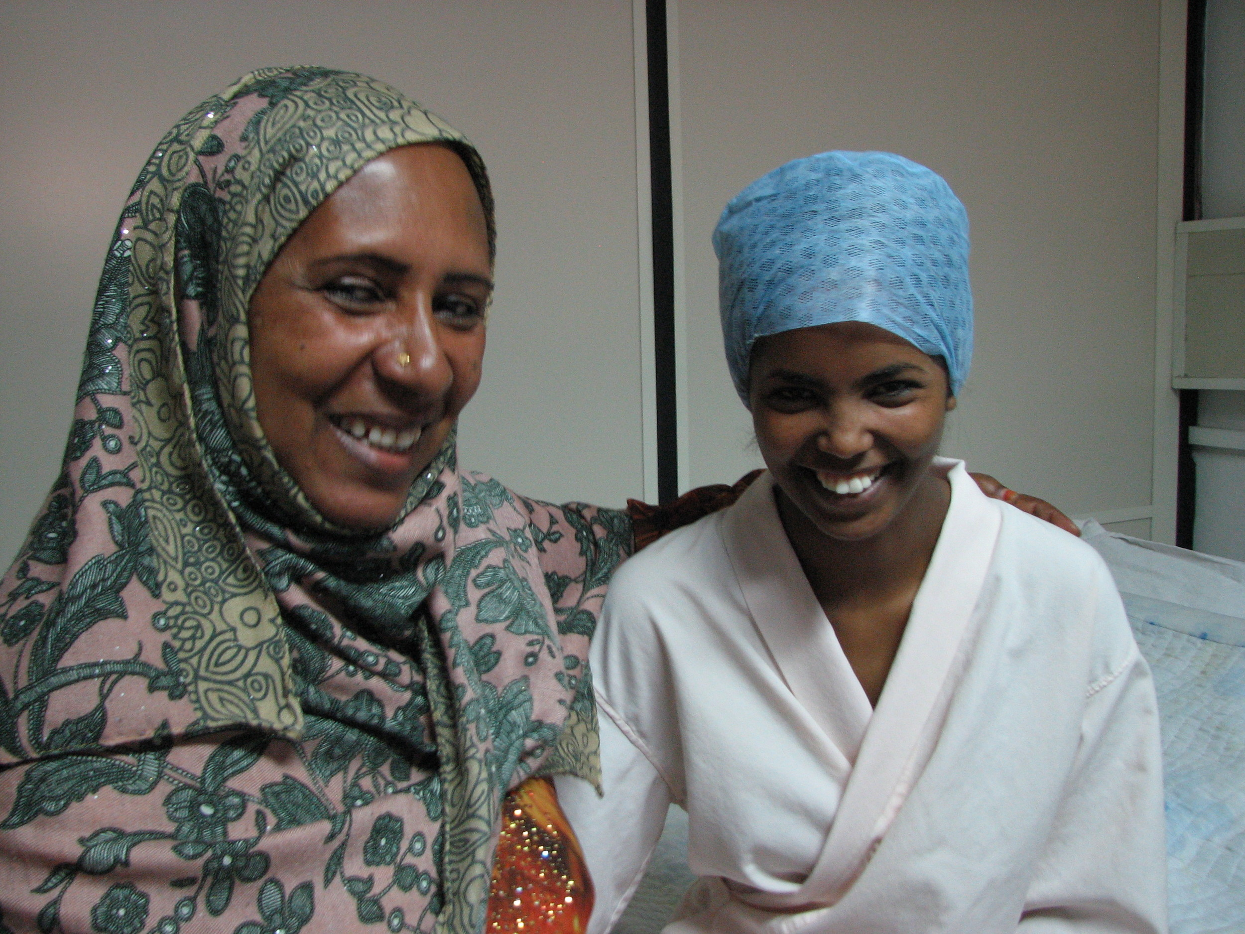 Aziza and her mother after her procedure