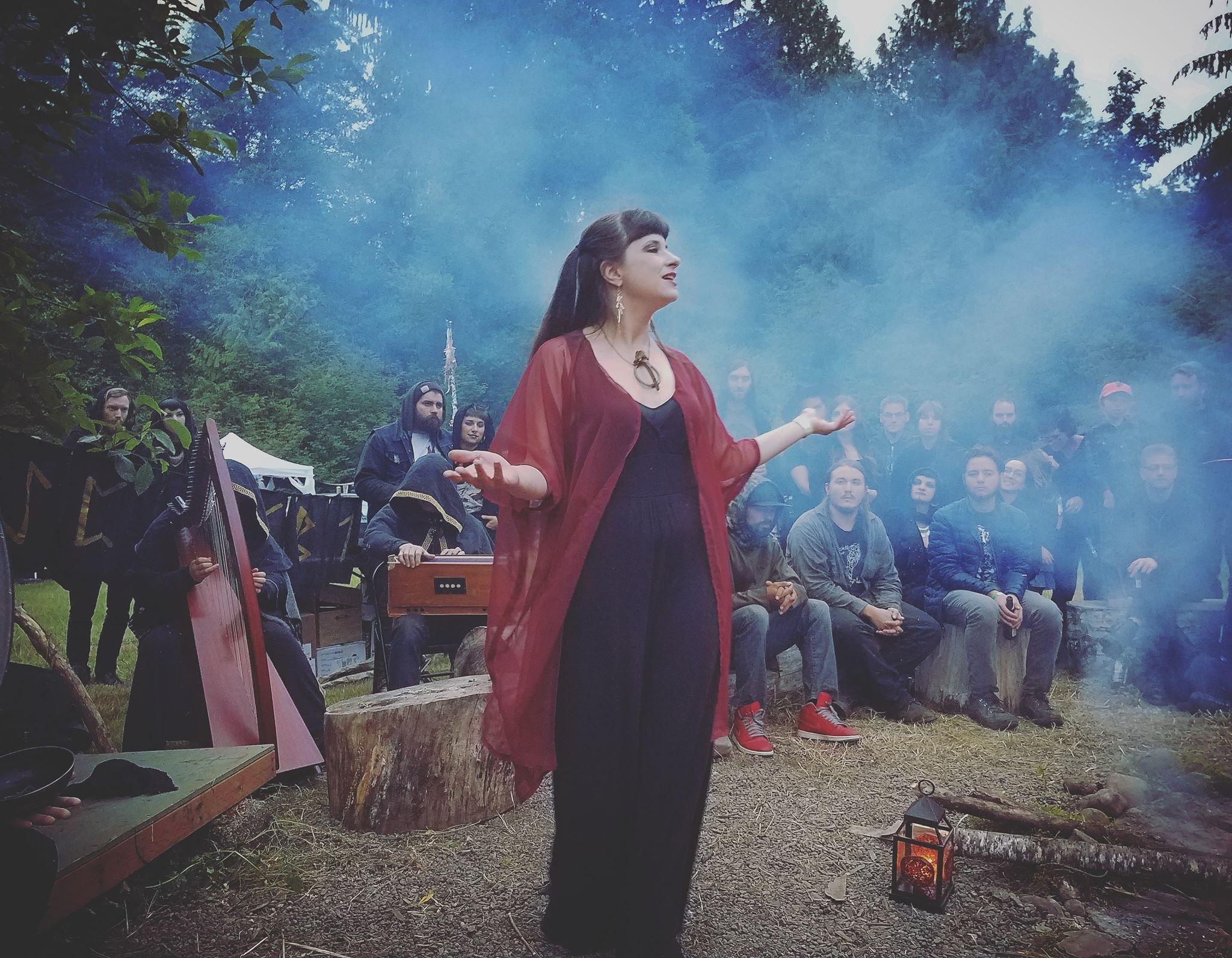 Performing with the ensemble Kertoa Kalevala, Ilana Hamilton retells the Old Norse poem  Vǫluspá . Litha Cascadia, Washington State, 2018. Image: Fjara Dawn McNally