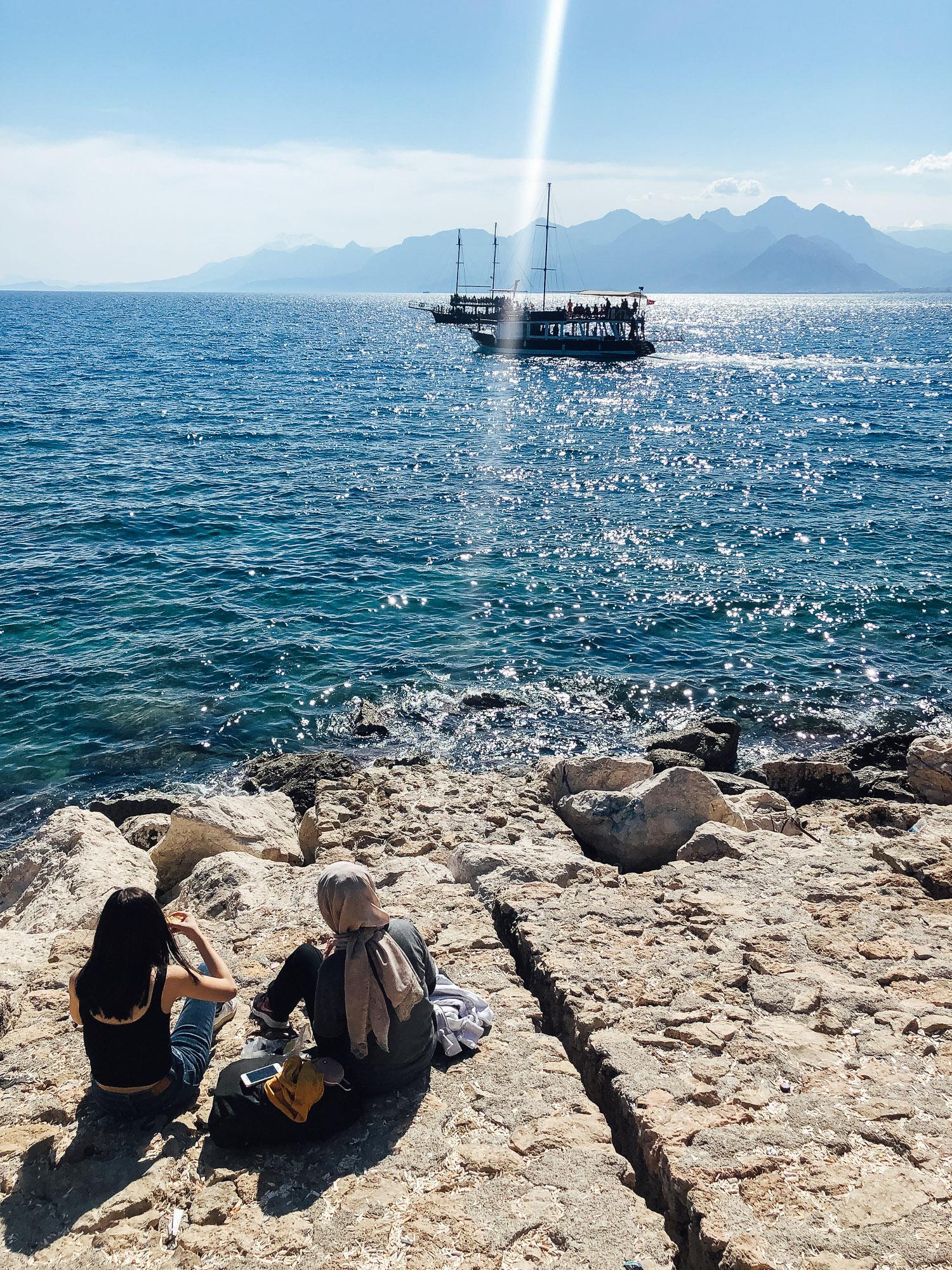 Teenage girls sharing stuffed mussels in Antalya.