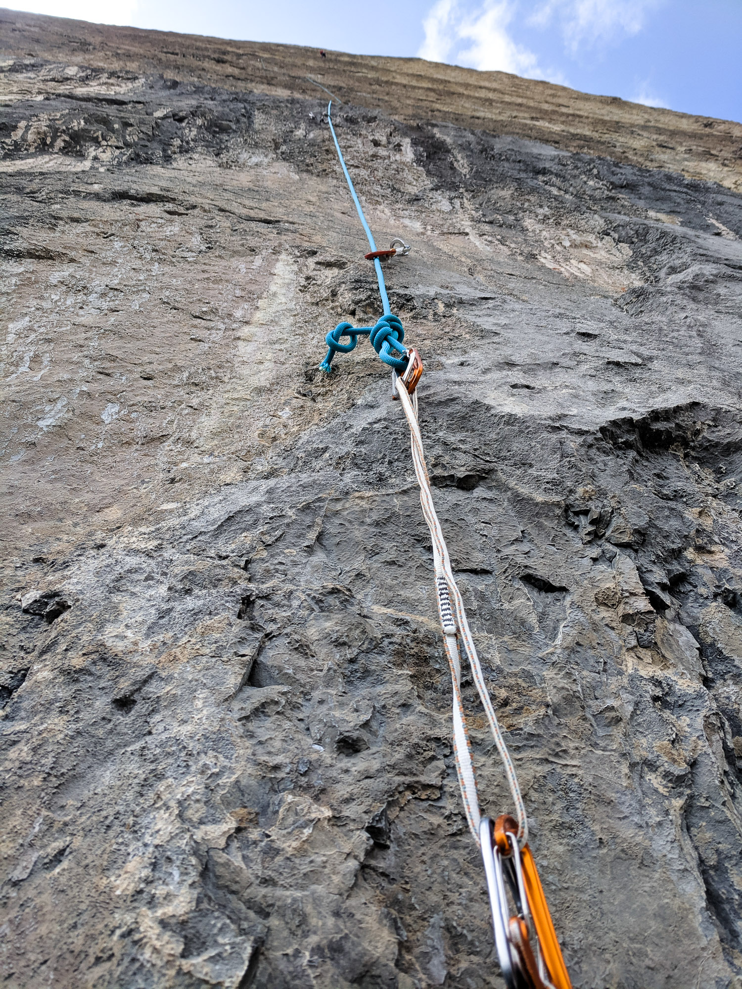 I quested up the first 3 headwall pitches in one rope length the first day. Because we hadn't extended the draws yet, the rope drag was heinous. Mike wasn't sure I'd make it so he extended the rope. Turns out we had just enough rope with the 90m.