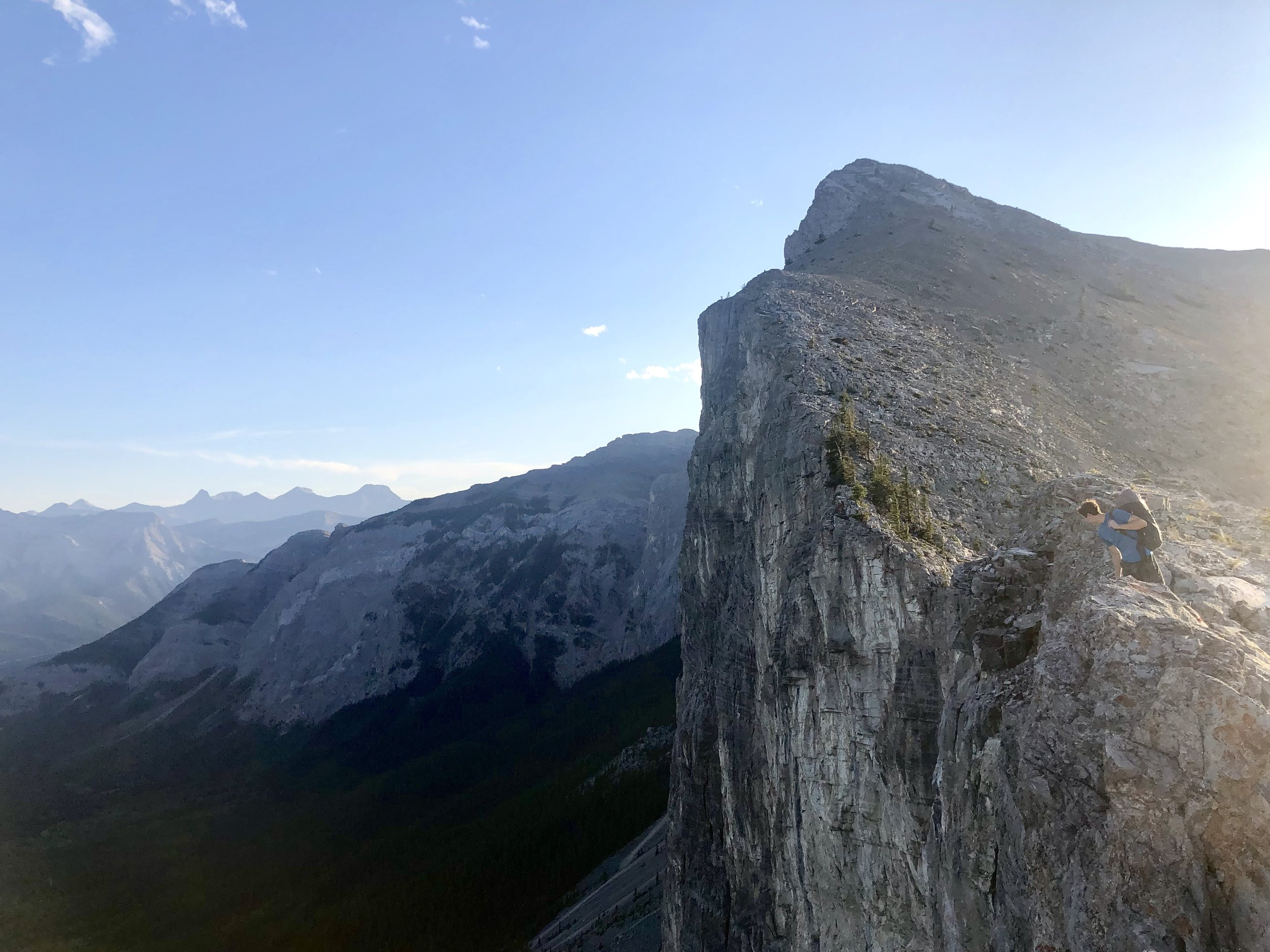 Mike looking over the edge of Yamnuska, where Blue Jeans tops out.