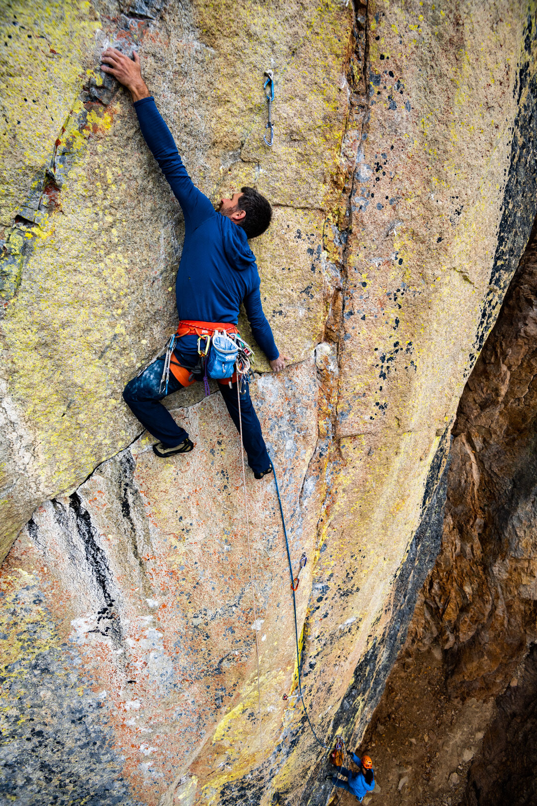 Mikey working through sculpted crystal pinches on the amazing 2nd pitch. Photo Austin Siadak.