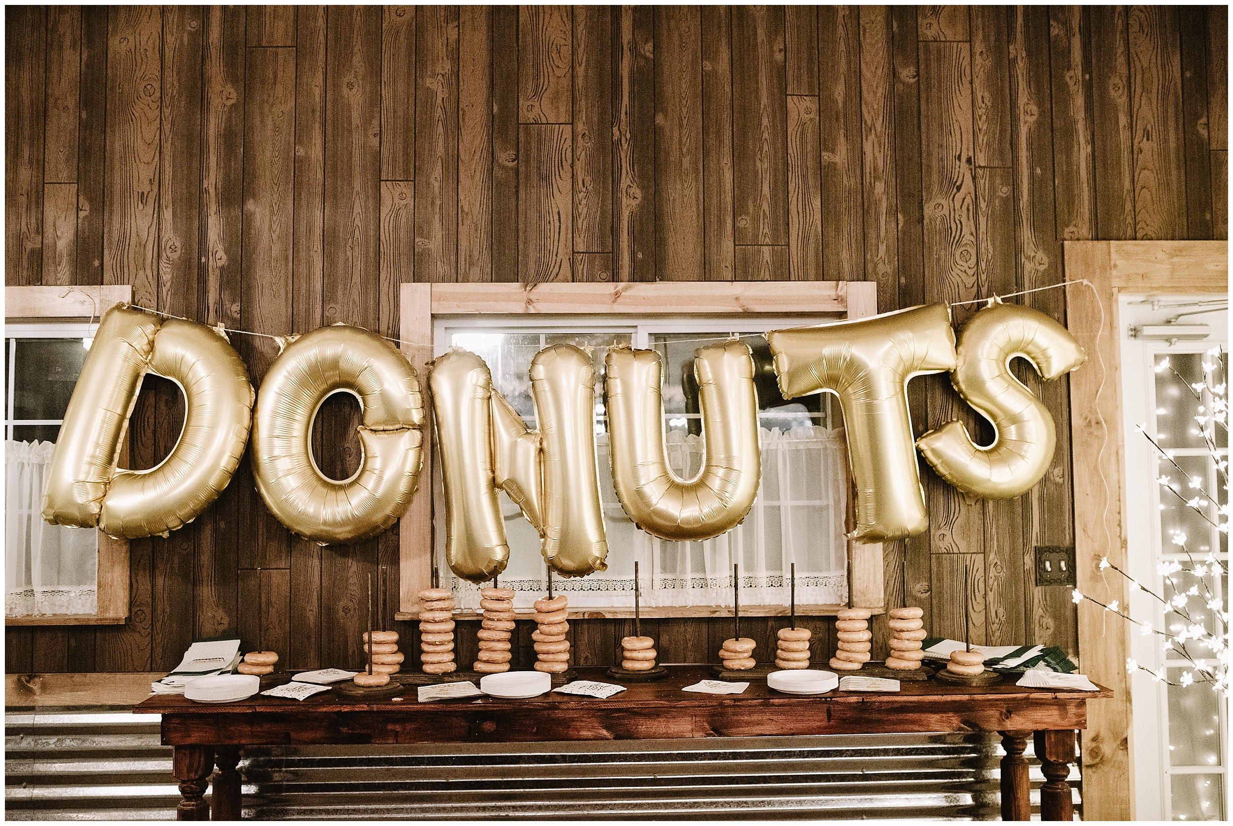 wedding photographer oklahoma reception decorations decor champagne table arrangements mr mrs mr. mrs.  viola kansas rustic timbers donuts gold balloon dessert